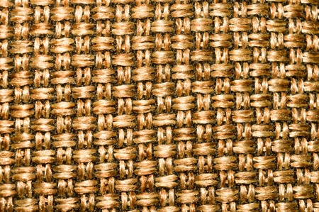 Burlap Sack pattern of Metal gold color for floor design or external wall decoration of a modern building with vibrant shiny material. Can use in fashion, handbags packaging cases or luxury items. Stock Photo