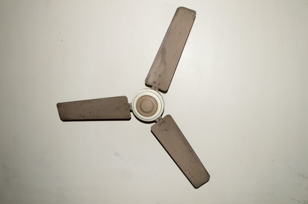 Antique and old electronic metal ceiling fan with three blades in vintage house Isolate on white background.