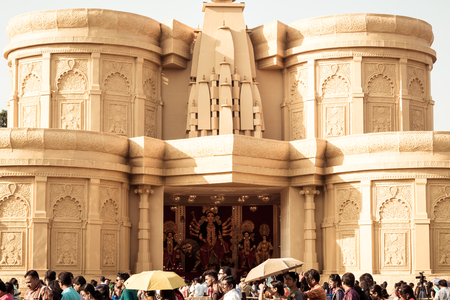KOLKATA , INDIA SEPTEMBER 26, 2017 - Decorated Durga Puja pandal in Saptami morning. Crowd gathered outside mandap. This is biggest religious festival for Kolkata, West Bengal, India..