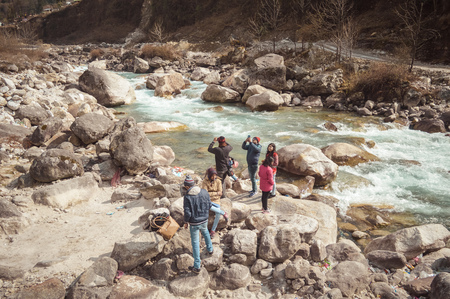 Teesta River front, Yumthang Valley, January 1 2019: Tourist people taking selfie too close to River after a recent news that group of teenager have drowned in river for photography amusement purposes Editorial