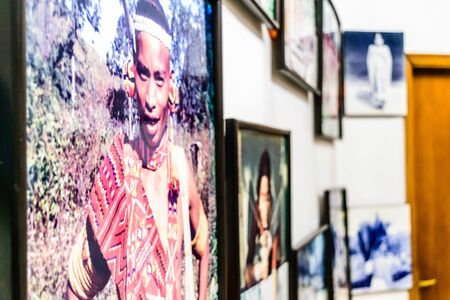 Academy of Fine Arts, Kolkata, India 1 May 2019 - Blur and Close up of artworks in museum hall wall where image of tribal people display painted by diverse regional and national artists. Sajtókép