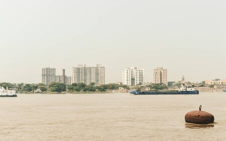 Landscape view of Kolkata (Bengali Kalikata) city capital West Bengal, on east bank Hooghly River (main channel Ganges / Ganga) Bay of Bengal. Calcutta is a city of land, river, water and sea. A dominant urban center of eastern India.