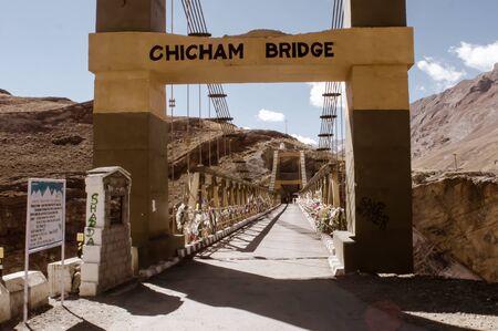 Chicham Bridge, Spiti Valley, Himachal Pradsh, India, December 2019 - Asia's New Highest suspension stiffened steel truss bridge over gorge and connecting Kibber with Chicham village over Samba Lamba Nallah on Kiato Chicham road. It reduces journey towa