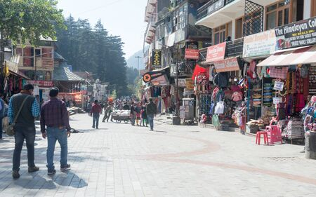 Manali Mall Road landscape in summer. A popular Hill station and tourist weekend gateway with full of showrooms, department stores, shops, restaurants cafes. Shimla Himachal Pradesh India October 2019