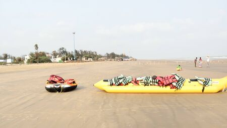 Inflatable adventurous fly fish raft of Fun Jet Ski watercraft wave runner vehicle placed in an empty sea beach for Jet skiing Water sports enthusiast at Goa Sea Beach, India South Asia Pac July 2019