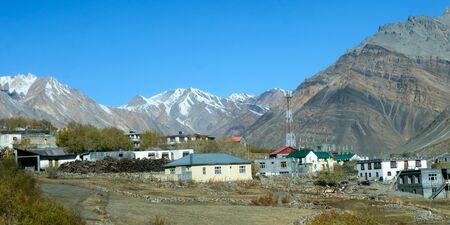 Village at Foothill of Himalayas. Small Villages In The Foothills Of Himalayan picturesque valley. A beautiful indian landscape of a town city at foothills of snow capped Mountain ranges. Kaza India
