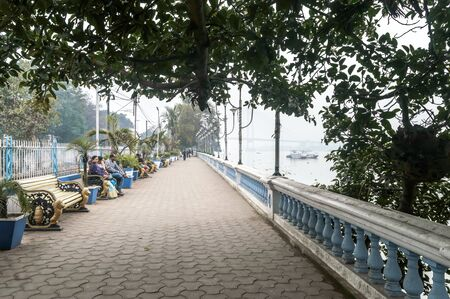 Beautiful Ganges riverside promenade paved Public Park in riverfront built for leisurely walk. Millennium Eco Tourism Recreational area on quiet relaxed evening sundown. Kolkata India January 2020