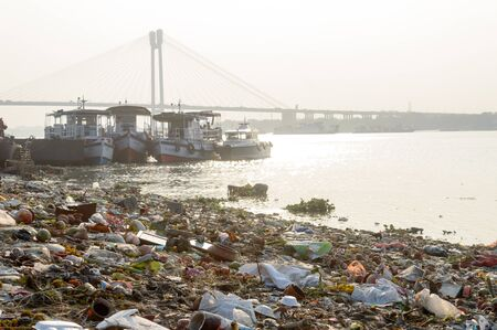 Ganges Water Pollution Polluted holy Ganga with human waste, industrial leftovers, domestic sewage and religious rituals from towns cities poses threat to health environment. Kolkata India May 2019