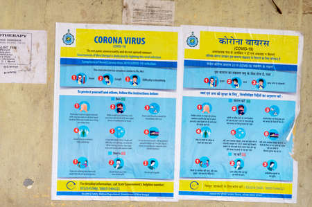 Coronavirus Safety Awareness Disease Control and Prevention slogan Poster on city street wall showing symptoms, Do's and Don'ts Practices Related to Coronavirus (COVID-19/2019-ncov), Middle East Respiratory Syndrome (MERS) and SARs. Kolkata India Marc