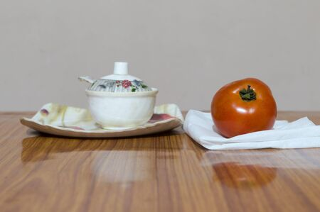 Tomato and Saucers on wooden dining table. Tomato sauce (Neapolitan sauce, salsa roja in Spanish, or salsa di pomodoro in Italian)