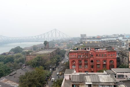 Panoramic riverside Kolkata city life in a winner foggy evening. Ariel view Kolkata in Hooghly riverbank West Bengal India South Asia Pacific. Photography from rooftop. Stock fotó