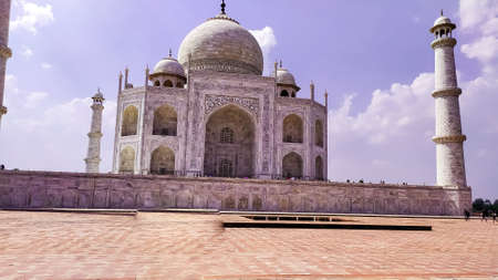 Front view Taj Mahal Tomb mausoleum with large pavilion in the foreground. It is a white marble of Mughal emperor Shah Jahan in memory of his wife Mumtaj. Taj Mahal is a jewel of Muslim art and masterpieces of world heritage. Agra, Uttar Pradesh India Sou