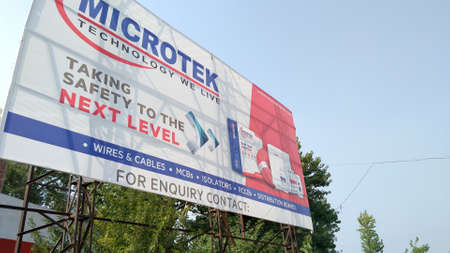 Outdoor Advertisement Banner or Street Banner or Hanging Banner Printing or Roadside Banners Advertising of Microtek India International in the main road. Delhi India, August 15, 2019