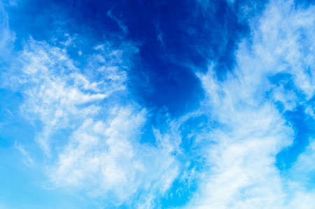 Blue sky background. Cloudy blue sky. Blue sky Abstract background with Dramatic tiny clouds floating. Fluffy Cloud Texture From A Perfect Cloudy spring time of day. Banco de Imagens