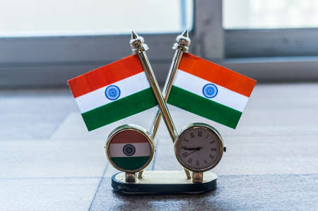 Indian flag clock. Indian Flag and Table Clock Flag. Flag with Golden Clock with Oval Shape Stand useful for Car Dashboard Desk Office Table Decoration. Home Decor Use and Gift object. Banco de Imagens