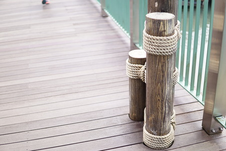 Wooden bridge with wooden pole Stock Photo