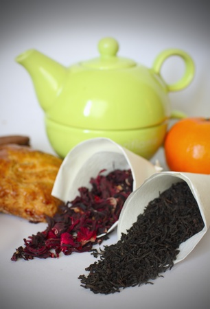 photo of two kinds of tea in a teapot and a sweet background.  Stock Photo - 10185095