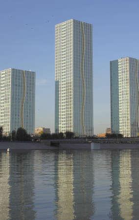 three modern buildings on the bank of Ishim. Astana. Kazakhstan.
