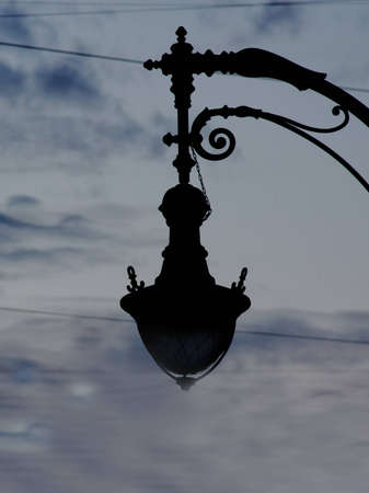 photo of the old street light in the sky