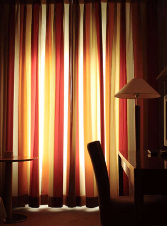 sensations: warm evening in the hotel room. Photos in yellow warm tone, Stock Photo