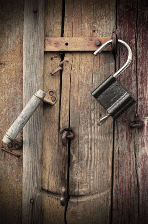 fragment of an old, unlocked the door. photo of retro style. Stock Photo - 12745033