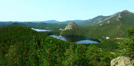 bright summer landscape depicting a lake Borovoe and rocks; covered with coniferous forest Stock Photo