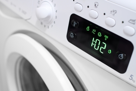 Display washing machine  Macro photo part of modern home washing machine Stock Photo