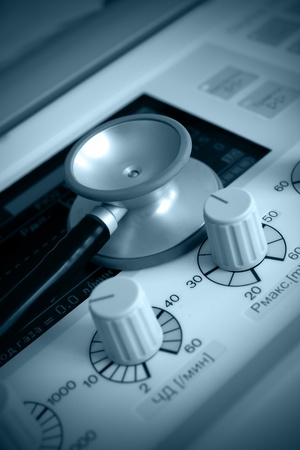 medical ventilator: lung ventilation apparatus and stethoscope. Medical symbols. Monochrome photos.