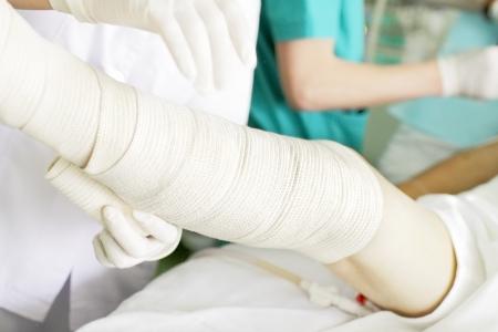 sprain: Bandaging of the legs with elastic bandage  photo
