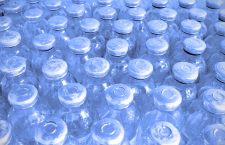 In the manufacturing room  set of glass bottles with medicine  Stock Photo