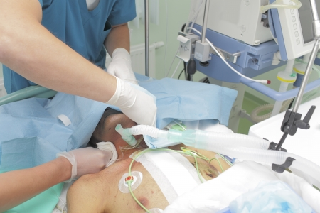 Teamwork with Patient seriously injured in the ICU  The doctor and nurse  Stock Photo