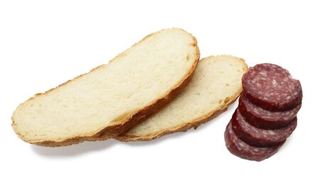 vespers: slices of bread and sliced sausage  isolated on white background  Stock Photo