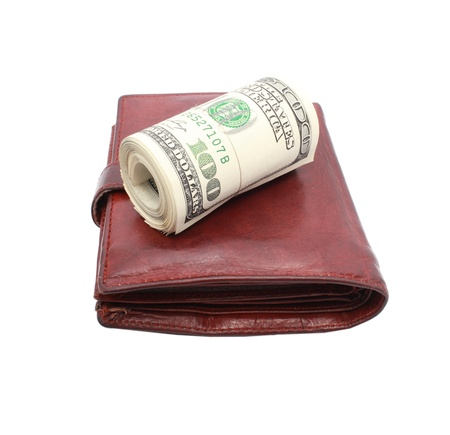 Roll of dollars on old leather purse photo