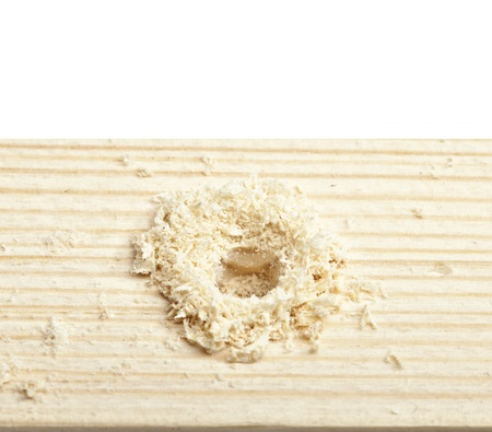 wood turning: hole in a wooden board  Isolated on white