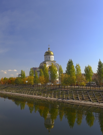 astana: Orthodox chapel and its reflection in the river
