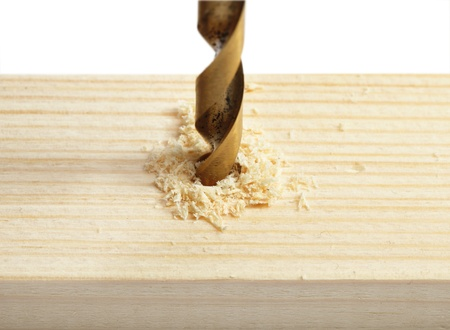 drilling hole in wood photo