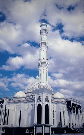 prayer tower: Fragment of mosque against cloudy sky  Stock Photo