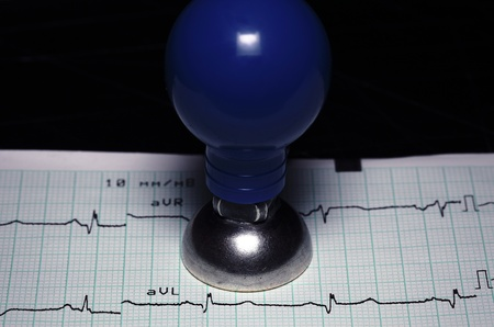 electrode: cardiology, healthcare concept  ECG and a metal electrode