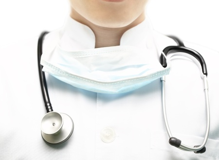 Doctor in a white coat with a stethoscope Stock Photo - 17150709