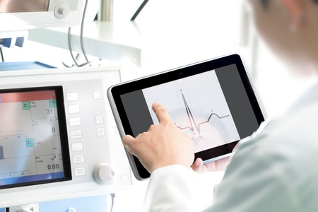 tablet pc in hand: Doctor at work with a digital tablet