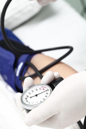 blood pressure gauge: Cardiologist measure blood pressure