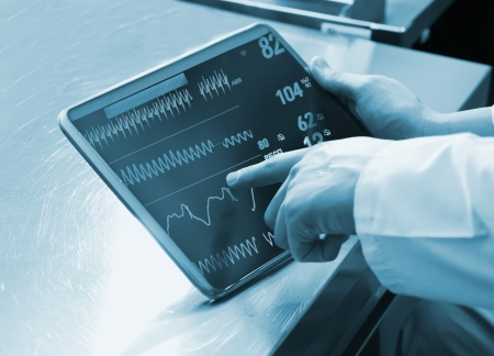 portable information device: Doctor Using Digital Tablet with medical parameters Stock Photo