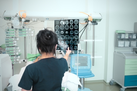 ray trace: CT scan at the hands of the doctor  Modern hospital
