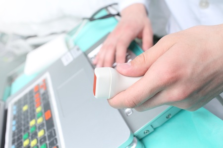 Doctor with ultrasound transducer  photo