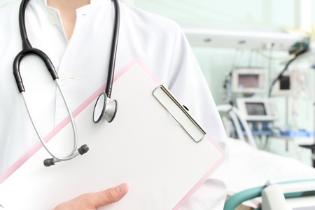 nursing record: Doctor with clipboard and stethoscope in hospital