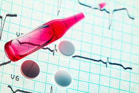 chemotherapy: Chemotherapy  Ampule and pills on the cardiogram