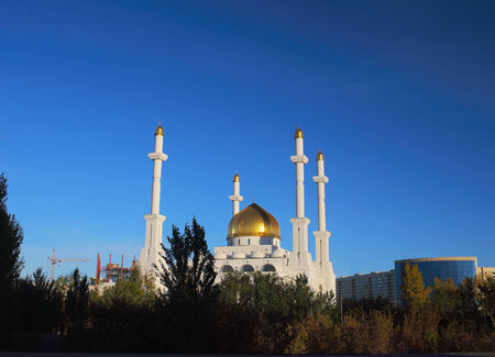 prayer tower: Evening landscape with a Muslim mosque in Astana