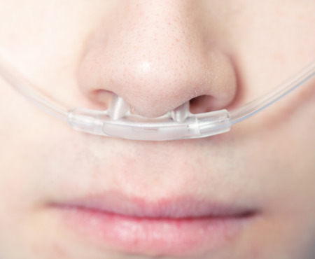 Asthmatic patient is breathing with oxygen  photo