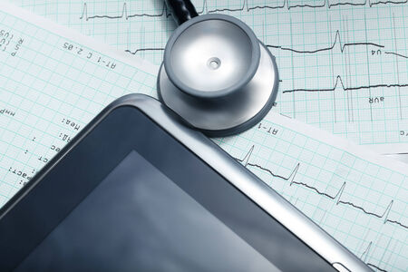 Tablet computer, stethoscope, cardiogram. Technologies in medicine  photo