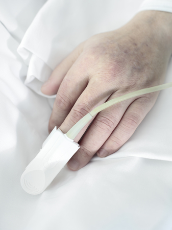 Hand an elderly patient man lying in bed  photo